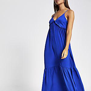 Robe longue bleue à fines bretelles et col en Và volants