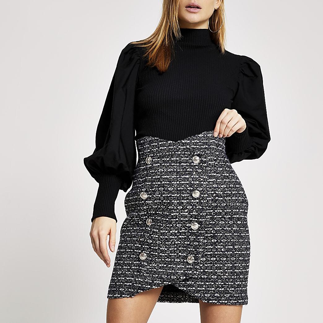 Mini-jupe boutonnéebleu marineà carreaux en maille bouclette