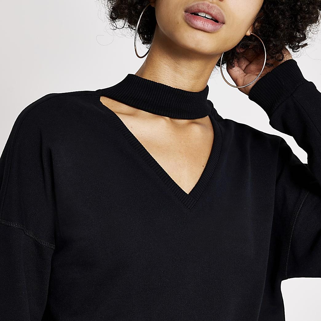 Zwarte choker sweater met uitsnede