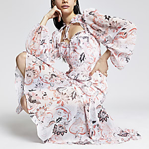 Roze midi-jurk met print, ruches en strik rond hals