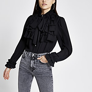 Zwarte blouse met ruches, lange mouwen en strik rond hals