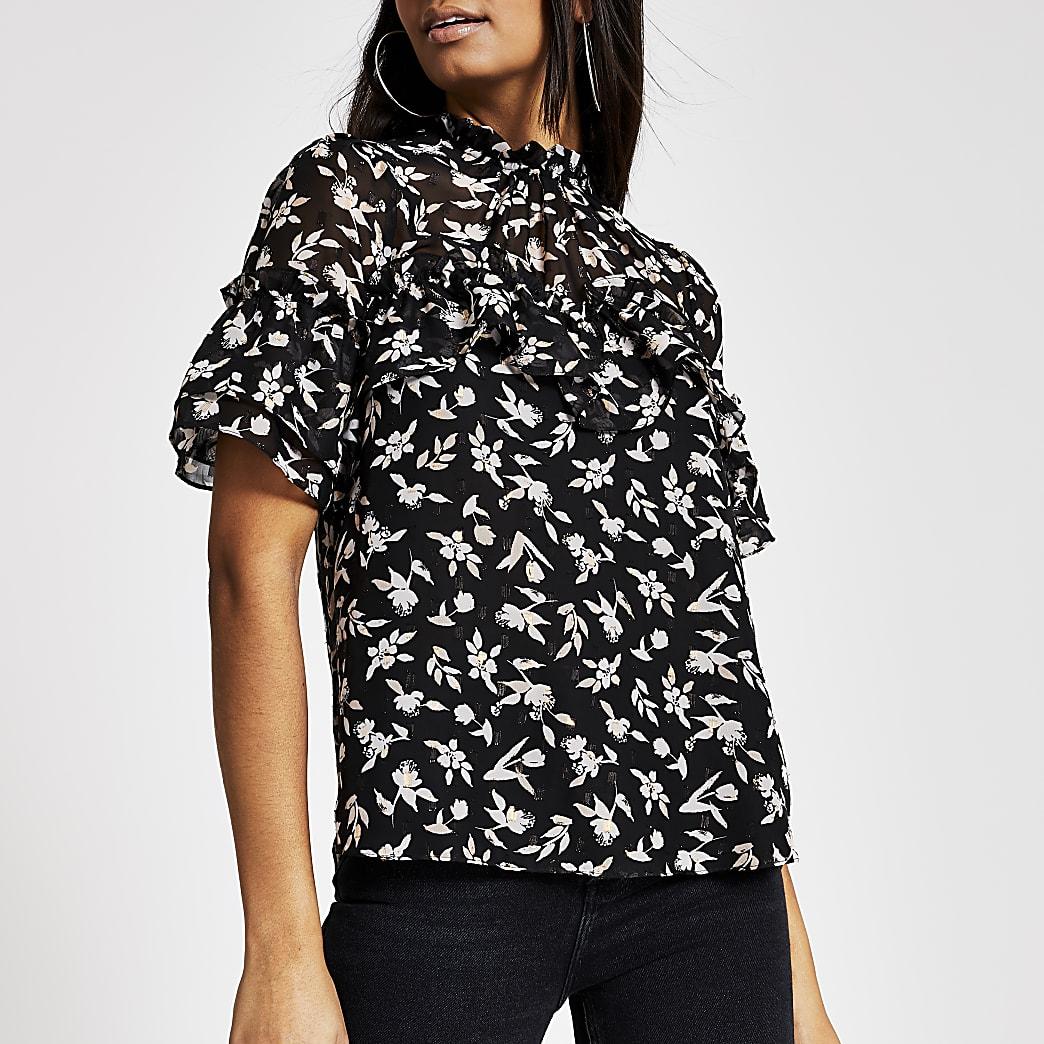 Schwarze, kurzärmelige Bluse mit Blumenmuster und Rüschen vorne
