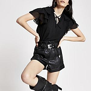 Zwarte blouse met strik bij de hals en franje