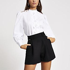 Shorts taille haute noirs avec boucles sur lescôtés