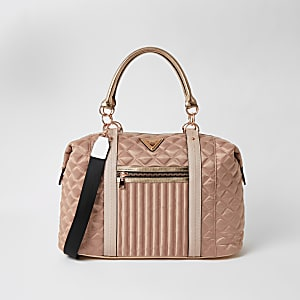 Pink quilted cross body weekend bag
