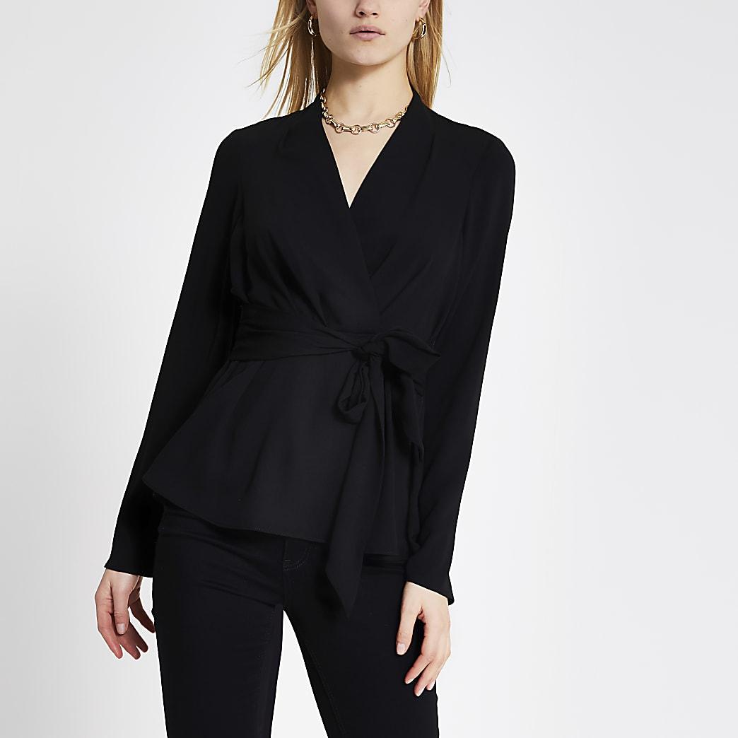 Zwarte blouse met lange mouwen en strik voor