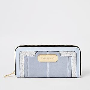 Blaue, glitzernde Geldbörse mit umlaufendem Reißverschluss