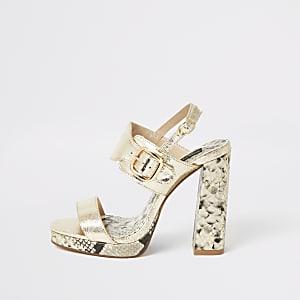 Goudkleurige tweedelige sandalen met plateauzool en brede pasvorm