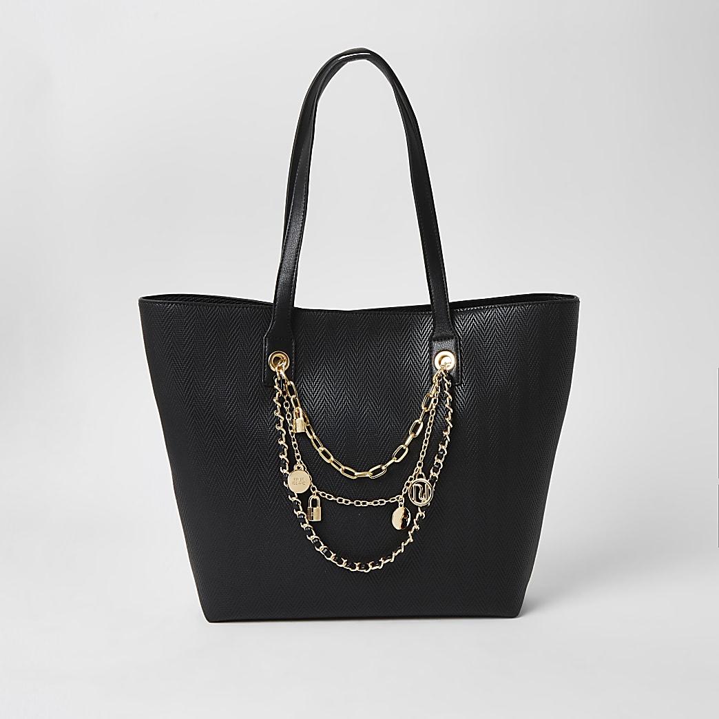 Schwarze Shopper-Tasche mit Kettenverzierung