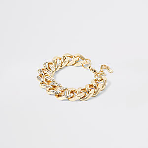 Goudkleurige stevige armband met kettingstukken met siersteentjes