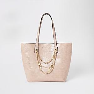 Roze shopper met reliëf en gelaagde RI-ketting
