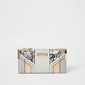 Grijze uitvouwbare portemonnee met slangenprint en uitsnedes