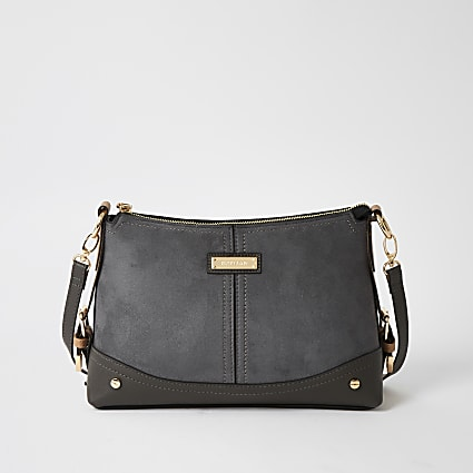 Grey suedette buckle side cross body bag