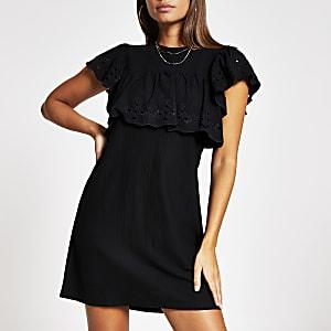 Schwarzes Minikleid mit Lochmusterrüschen