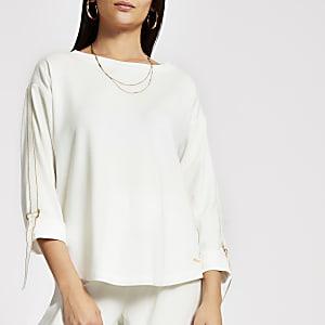 Cremefarbenes, langärmeliges Sweatshirt mit Glitzerband