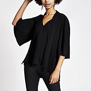 Zwarte blouse met V-hals en strik