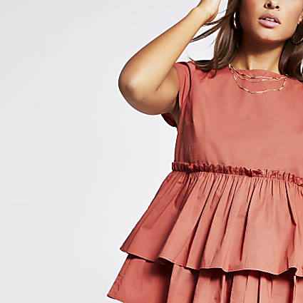 Rust short sleeve peplum frill poplin top