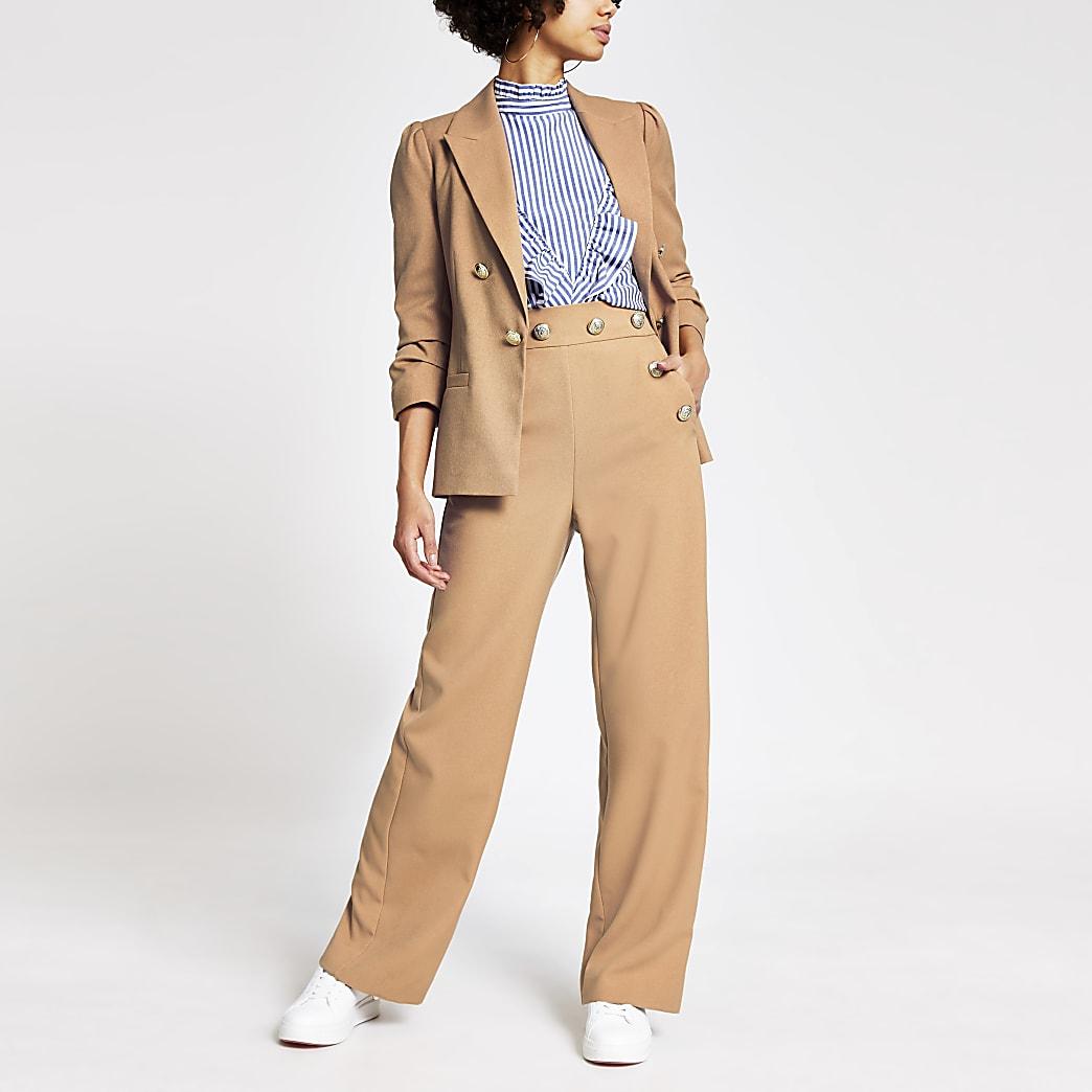 Pantalon large beige à taille haute boutonnée