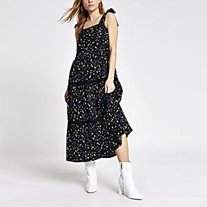 Zwarte gesmokte midi-jurk met bloemenprint en banden