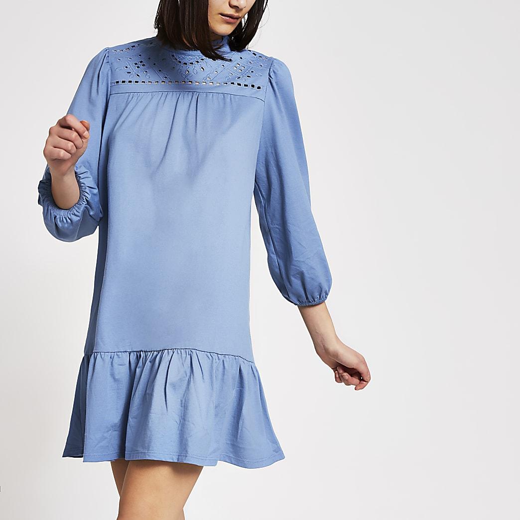 Blauwe gesmokte mini-jurk met lange broderie mouwen