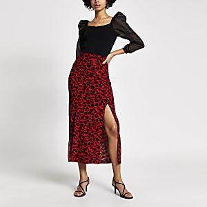 Rode midi-rok met bloemenprint en uitsnede bij been