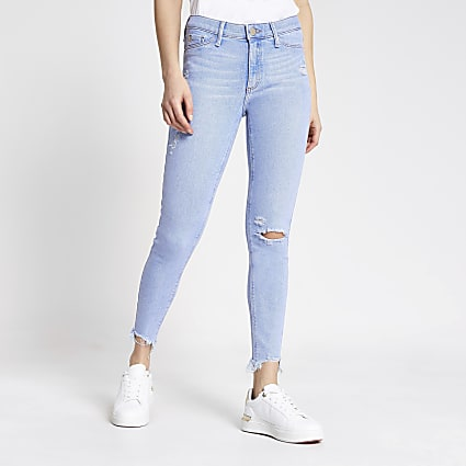 Bright blue ripped Molly mid rise jeggings