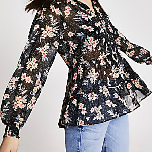 Schwarze Bluse mit Blumenmuster und Rüschensaum