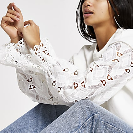Petite white broderie sleeve loose sweatshirt