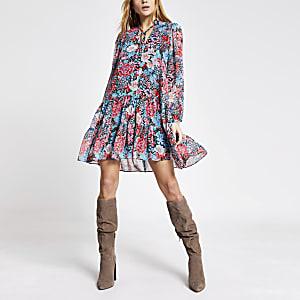 Blauwe gesmokte mini-jurk met lange mouwen en bloemenprint