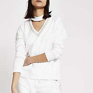 Crèmekleurige versierde sweater met chokeren V-hals