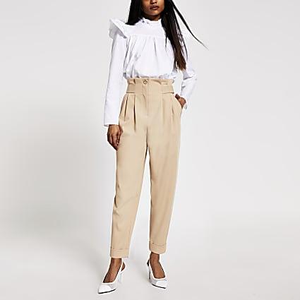 Petite beige buckle waist peg leg trousers