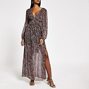 Bruine maxi-jurk met strikceintuur, print en diepe hals