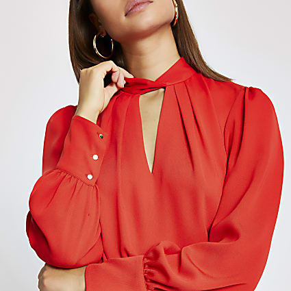 Orange  twisted neck long sleeve blouse