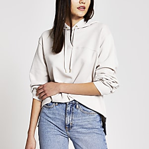 Cremèkleurigeloose-fit hoodie met lange mouwen