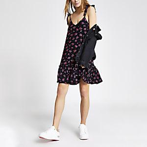 Schwarzes Minikleid mit Schößchen-Saum und Blumenmuster