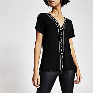 Zwart fluwelen T-shirt verfraaid met oogjes