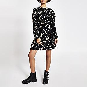 Zwarte mini-jurk met bloemenprint en ruches