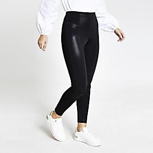 Schwarze, metallisch beschichtete Leggings