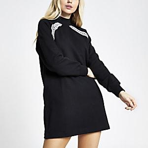 Zwarte sweaterjurk met RI-bies en lange mouwen