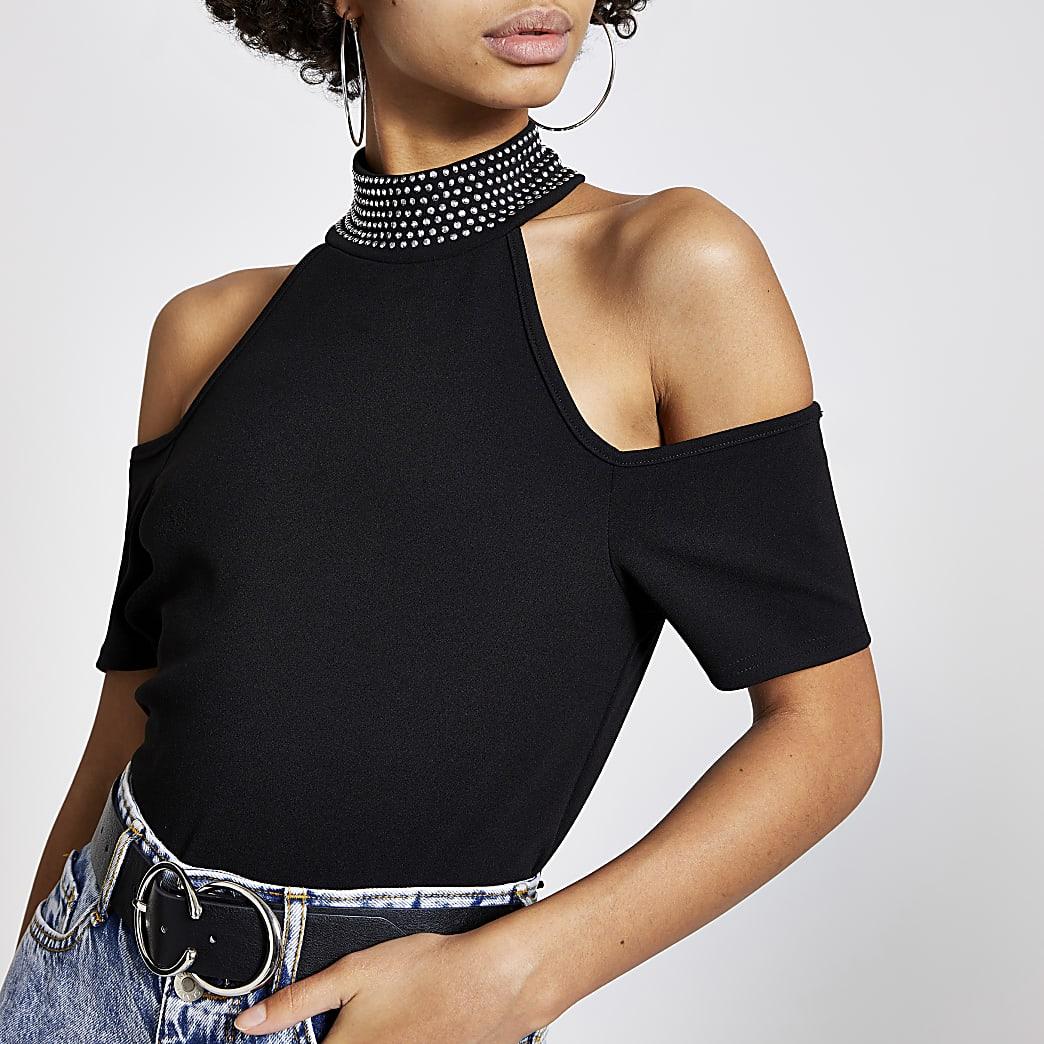T-shirt noirà col montant cloutéet épaules dénudées