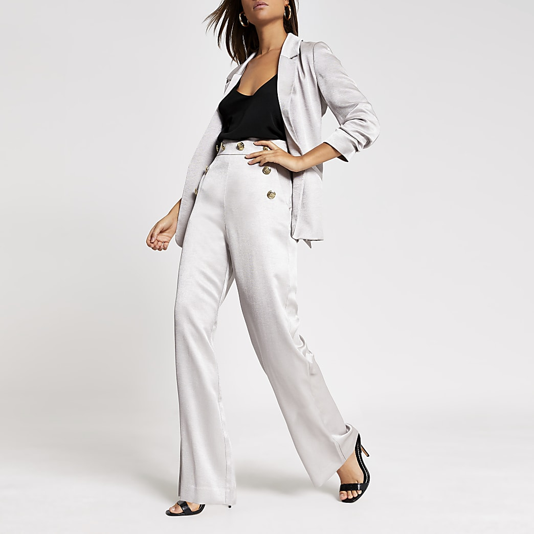 Zilverkleurige broek met wijde pijpen en knopensluiting