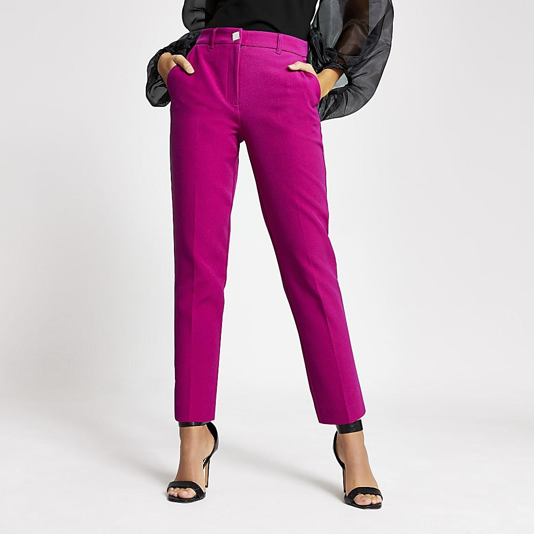 Pantalon cigarette rose à bouton en strass