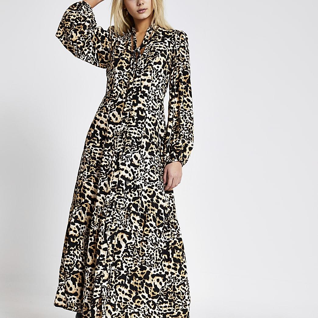 Beige midi-jurk met luipaardprint en strik bij de hals