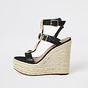 Schwarze Sandalen mit verzierten Riemen undKeilabsatz