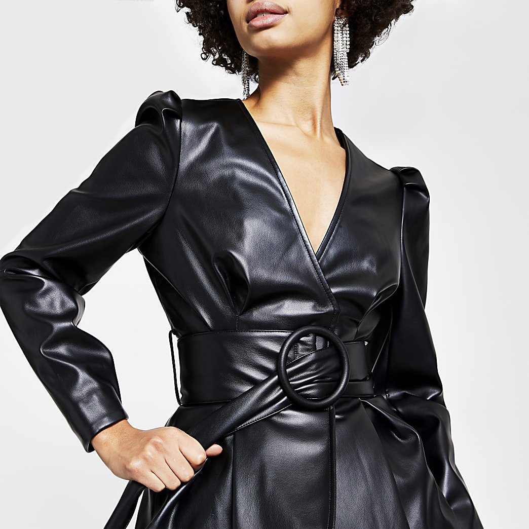 Black faux leather long sleeve belted top
