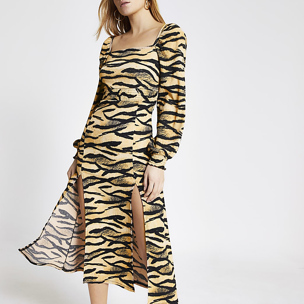 Beige midi-jurk met dierenprint en shirred taille