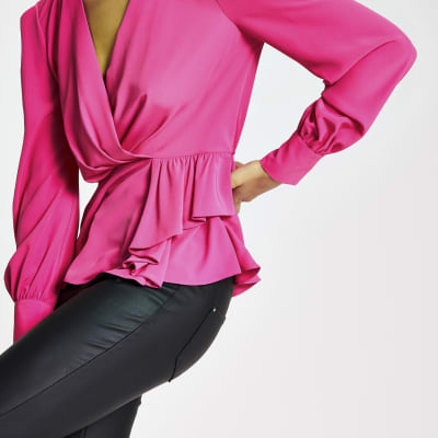 Pink long sleeve peplum blouse