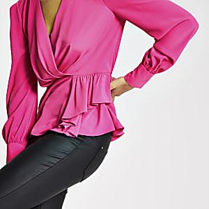 Roze blouse met peplum en lange mouwen