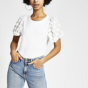 T-shirt blancà manches ornées de fleurs