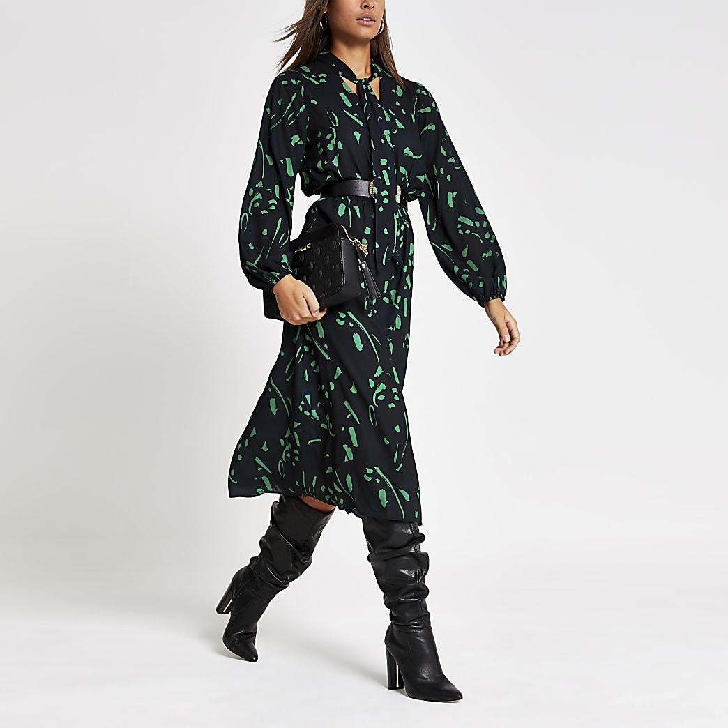 Robe mi-longue vert imprimé avec col V noué